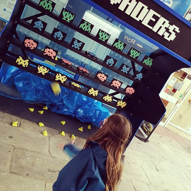 Space Invaders manual game at Shop Front Festival, located outside on the street.