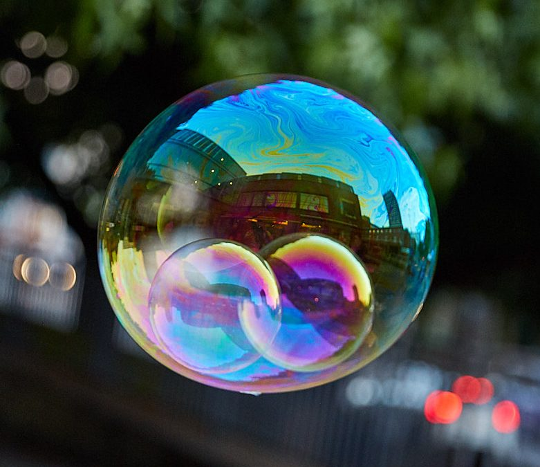 Soap bubbles. Bubbles within a bubble - a real image.