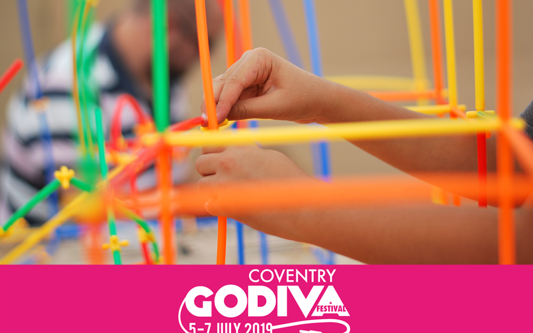 Colourful straws being used for child play at the Godiva Festival.